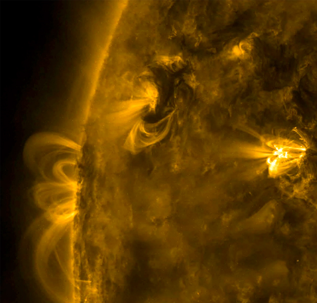On Jan. 20, 2017, NASA's Solar Dynamics Observatory captured a small area of the sun highlighted three active region. Over half a day this active region sent dark swirls of plasma and bright magnetic arches twisting and turning above it.
