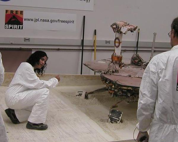 Mars Exploration Rover team members on July 21, 2009, tested how altering the order in which individual wheels turn for steering affects how those turns dig the wheels deeper into soft soil. From left: Alfonso Herrera, Vandana Verma, Bruce Banerdt.