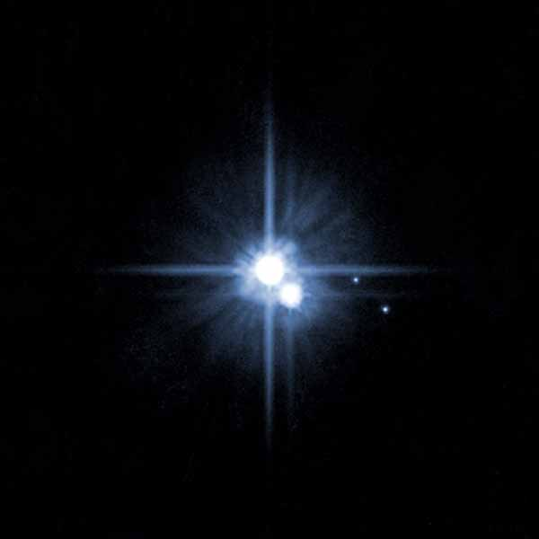 A pair of small moons photographed by NASA's Hubble Space Telescope discovered orbiting Pluto in 2005 now have official names: Nix and Hydra.