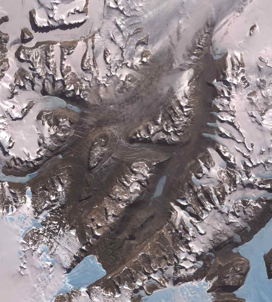 The McMurdo Dry Valleys are a row of valleys west of McMurdo Sound, Antarctica. They are so named because of their extremely low humidity and lack of snow and ice cover. This image was acquired December 8, 2002 by NASA's Terra spacecraft.