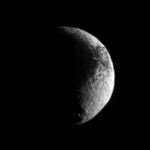 NASA's Cassini spacecraft examines the rough dark-light dichotomy of the terrain on Saturn's moon Iapetus. Lit terrain seen here is on the Saturn-facing side of Iapetus.