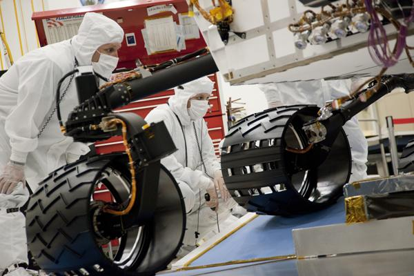 Test operators monitor how NASA's Mars rover Curiosity handles driving over a ramp during a test on Sept. 10, 2010, inside the Spacecraft Assembly Facility at NASA's Jet Propulsion Laboratory, Pasadena, Calif.
