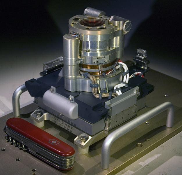The Mars Hand Lens Imager (MAHLI) camera will fly on NASA's Mars Science Laboratory mission, launching in late 2011. This photo of the camera was taken before MAHLI's November 2010 installation onto the robotic arm of the mission's Mars rover, Curiosity.