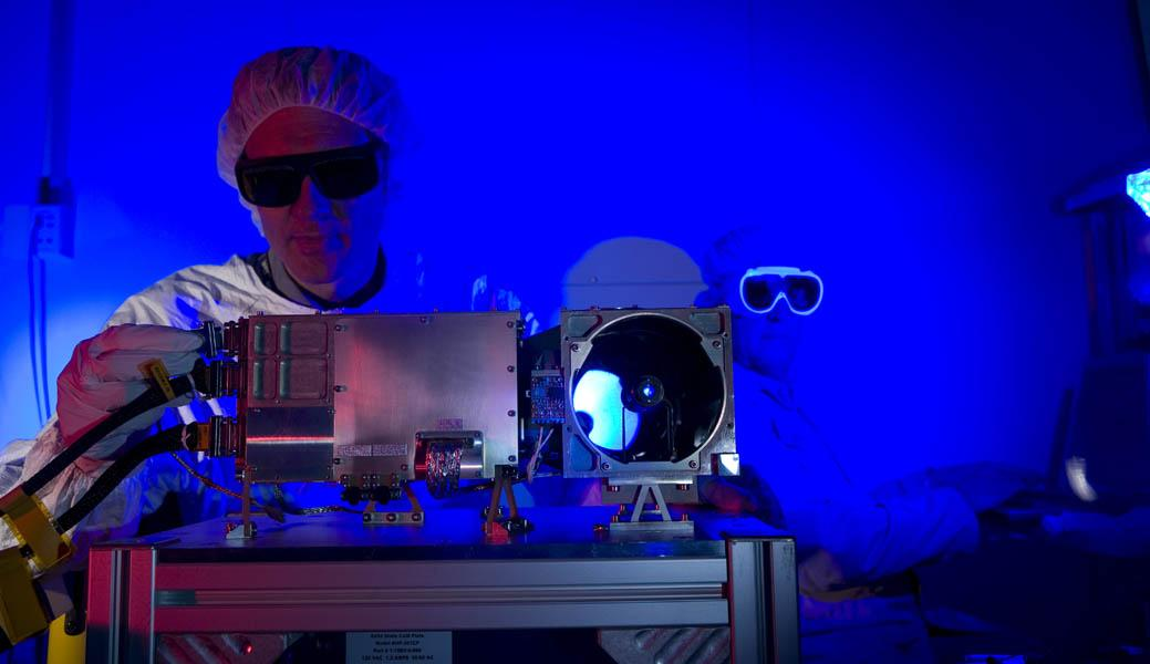 Researchers prepare for a test of the Chemistry and Camera (ChemCam) instrument that will fly on NASA's Mars Science Laboratory mission; researchers are preparing the instrument's mast unit for a laser firing test.