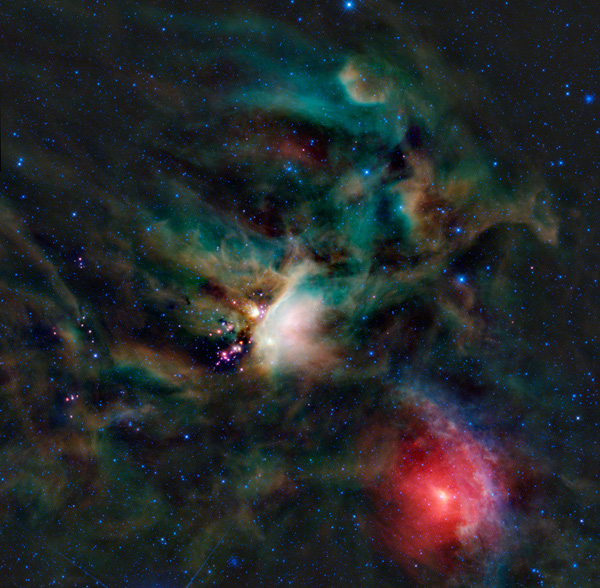 A rich collection of colorful astronomical objects is revealed in this picturesque image of the Rho Ophiuchi cloud complex from NASA's Wide-field Infrared Explorer; the cloud is found rising above the plane of the Milky Way in the night sky.