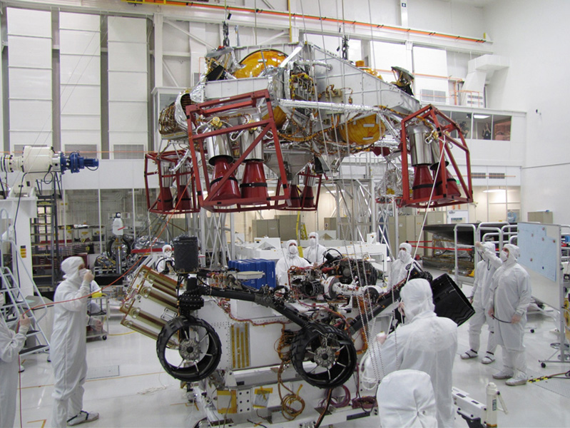 Spacecraft specialists test the descent stage and rover of the Mars Science Laboratory in this scene from the Spacecraft Assembly Facility at NASA's Jet Propulsion Laboratory, Pasadena, Calif.