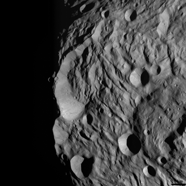 NASA's Dawn spacecraft obtained this image of asteroid Vesta's south polar scarp with its framing camera on August 12, 2011. The image was taken through the framing camera's clear filter. The image has a resolution of about 260 meters per pixel.