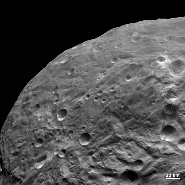 NASA's Dawn spacecraft obtained this image with its framing camera on Aug. 26, 2011. The detail in this image shows impacts of all sizes, grooves, scarps and smooth areas.