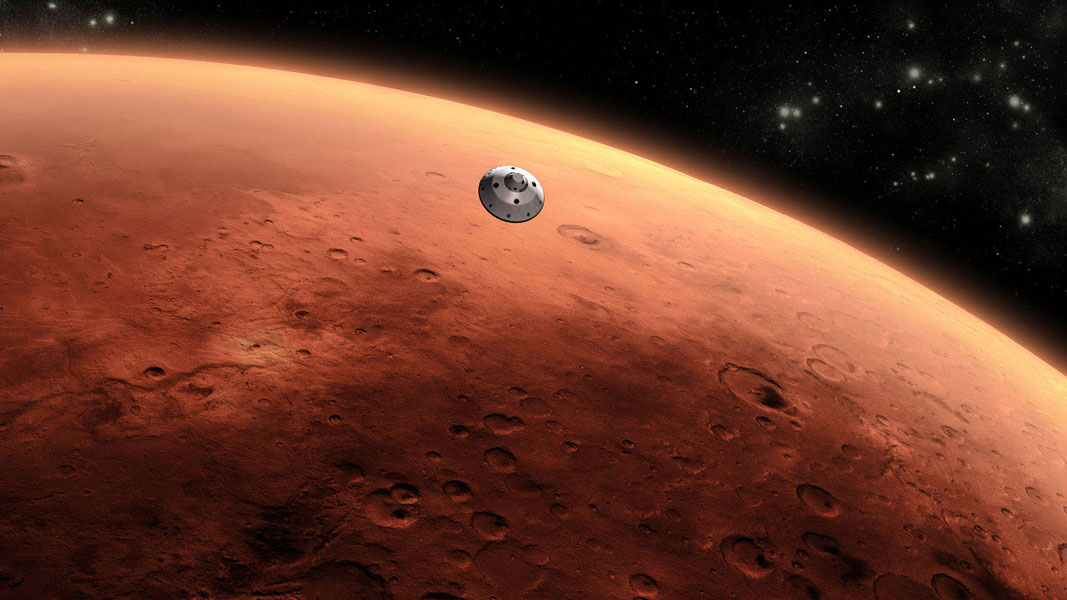 This is an artist's concept of NASA's Mars Science Laboratory spacecraft approaching Mars. The Curiosity rover is safely tucked inside the spacecraft's aeroshell.