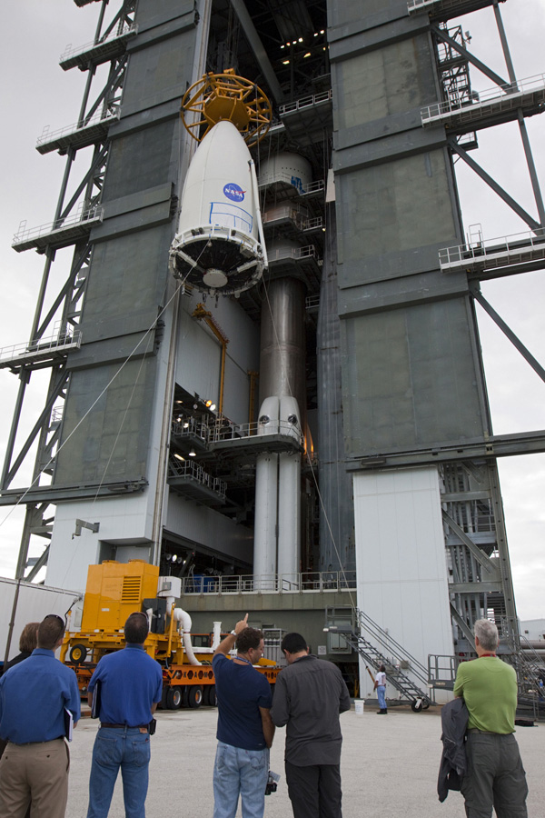 Employees at Space Launch Complex 41 of Cape Canaveral Air Force Station, Fla., keep watch as the payload fairing containing NASA's Mars Science Laboratory spacecraft is lifted up the side of the Vertical Integration Facility on Nov. 3, 2011.