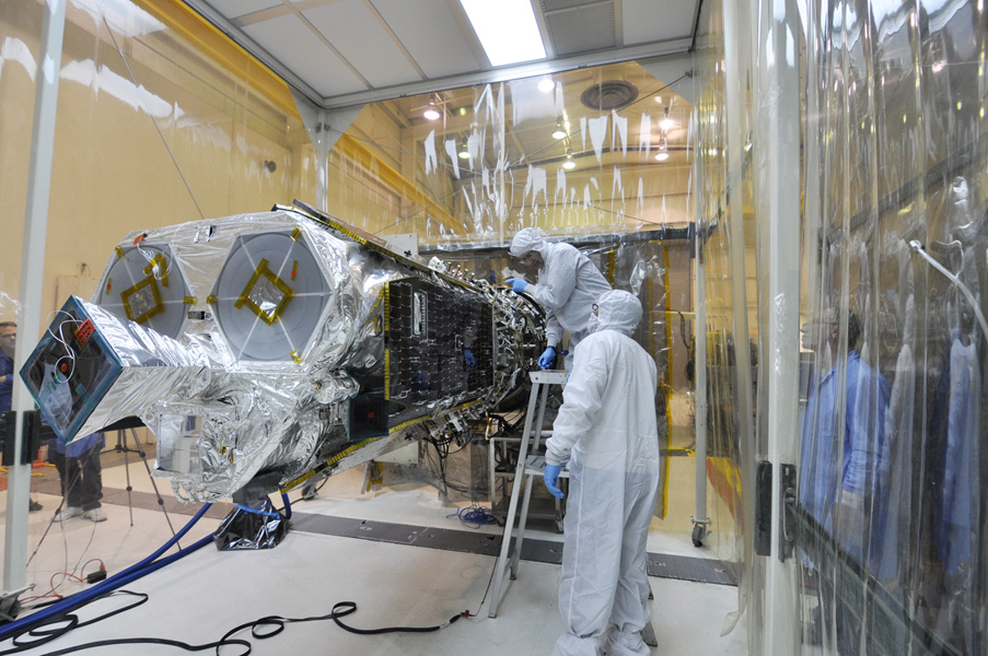 Inside an environmental enclosure at Vandenberg Air Force Base's processing facility in California, technicians complete the final steps in mating NASA's Nuclear Spectroscopic Telescope Array (NuSTAR) and its Orbital Sciences Pegasus XL rocket.
