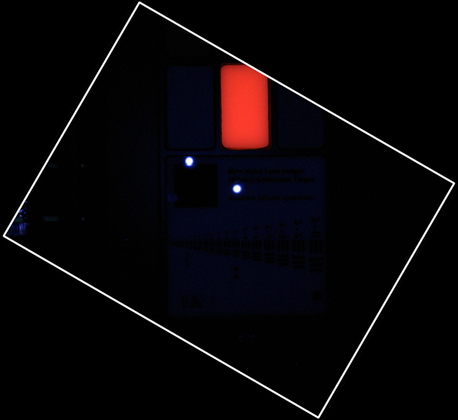 During pre-flight testing in March 2011, the Mars Hand Lens Imager (MAHLI) camera on NASA's Mars rover Curiosity took this image of the MAHLI calibration target under illumination from MAHLI's two ultraviolet LEDs (light emitting diodes).