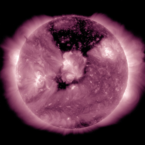 A substantial coronal hole had rotated so that it temporarily faced right towards Earth (May, 17-19, 2016). This coronal hole area is the dark area at the top center of this image from NASA's Solar Dynamics Observatory.