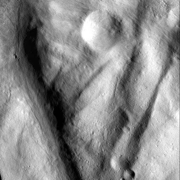 This image, from NASA's Dawn spacecraft, shows rock material that has moved across the surface and flowed into a low area in the ridged floor of the Rheasilvia basin on asteroid Vesta.