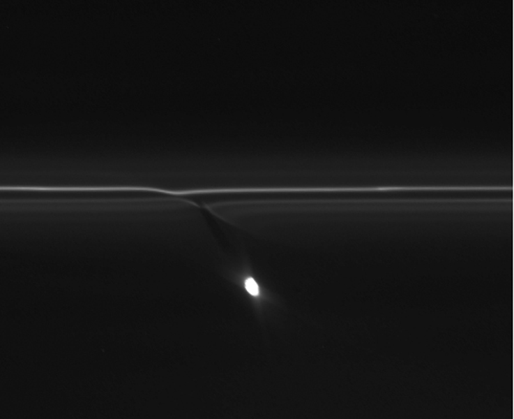 In this image from NASA's Cassini spacecraft, the gravitational pull of Saturn's moon Prometheus creates patterns in Saturn's F ring.