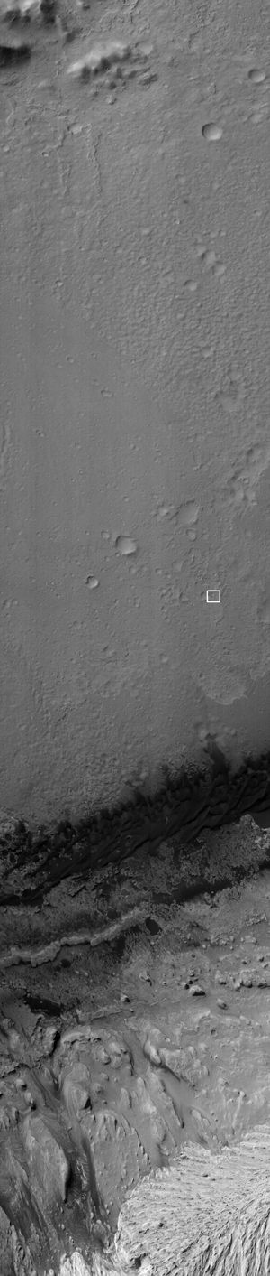 NASA's Curiosity rover and its parachute were spotted by NASA's Mars Reconnaissance Orbiter as Curiosity descended to the surface on Aug. 5 PDT (Aug. 6 EDT). Curiosity and its parachute are in the small white box at center.
