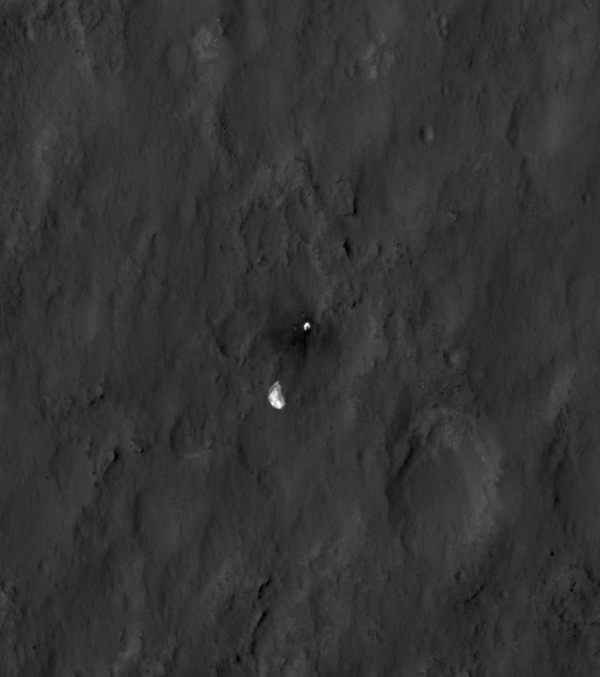 This close-up view shows the rover Curiosity's parachute and back shell strewn across the surface of Mars. The image was captured by NASA's Mars Reconnaissance Orbiter about 24 hours after the parachute helped guide the rover to the surface.