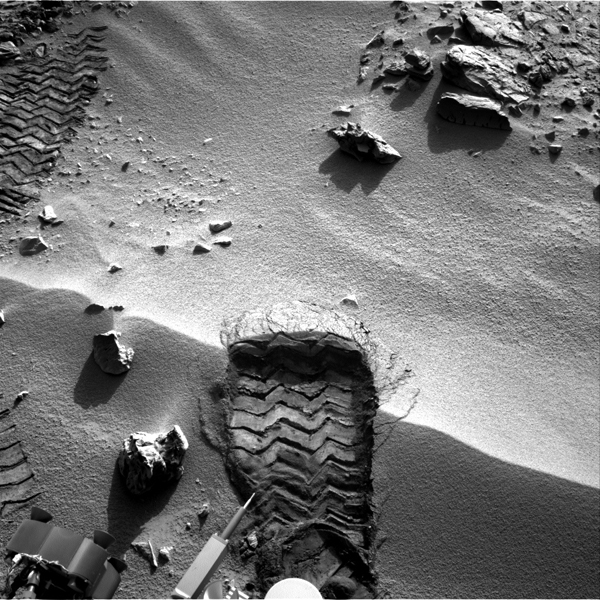 NASA's Mars rover Curiosity cut a wheel scuff mark into a wind-formed ripple at the 'Rocknest' site to give researchers a better opportunity to examine the particle-size distribution of the material forming the ripple.