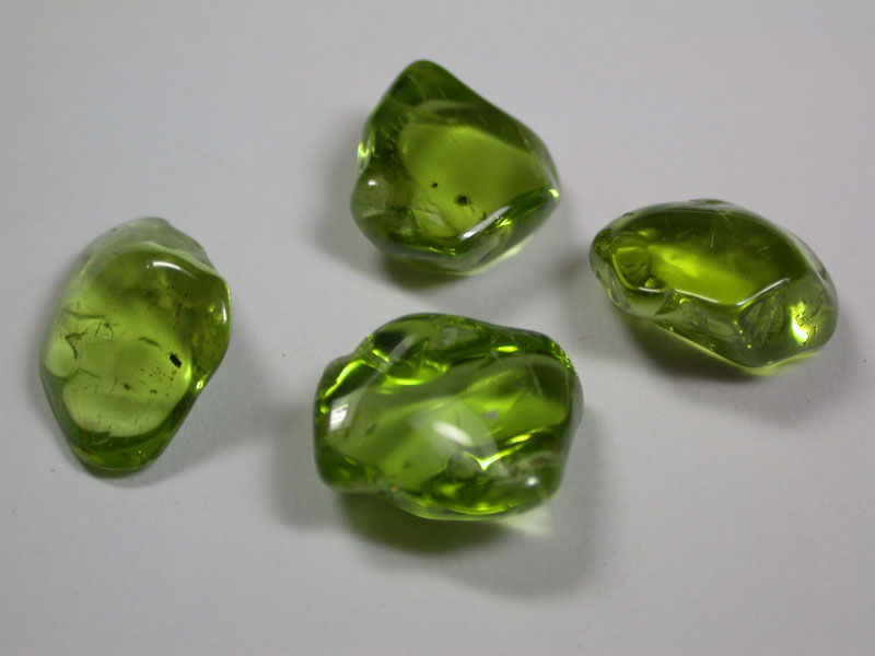 The semi-precious gem peridot is a variety of olivine. NASA's Curiosity rover shows the diffraction signature, or 'fingerprint,' of the mineral olivine, shown here on Earth in the form of tumbled crystals.