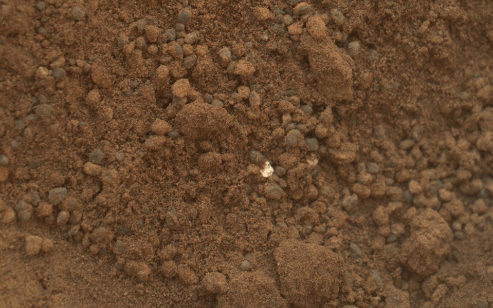 The mission's science team assessed the bright particles in this scooped pit to be native Martian material rather than spacecraft debris as seen in this image from NASA's Mars rover Curiosity as it collected its second scoop of Martian soil.