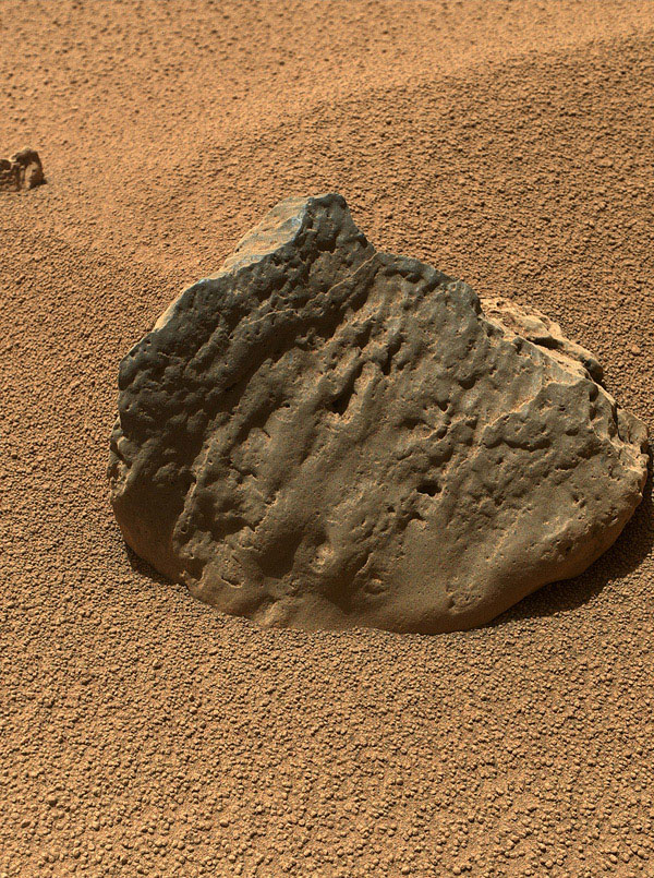 'Et-Then' is located near the rover's front left wheel, where the rover has been stationed while scooping soil at the site called 'Rocknest' in this image from NASA's Curiosity spacecraft.
