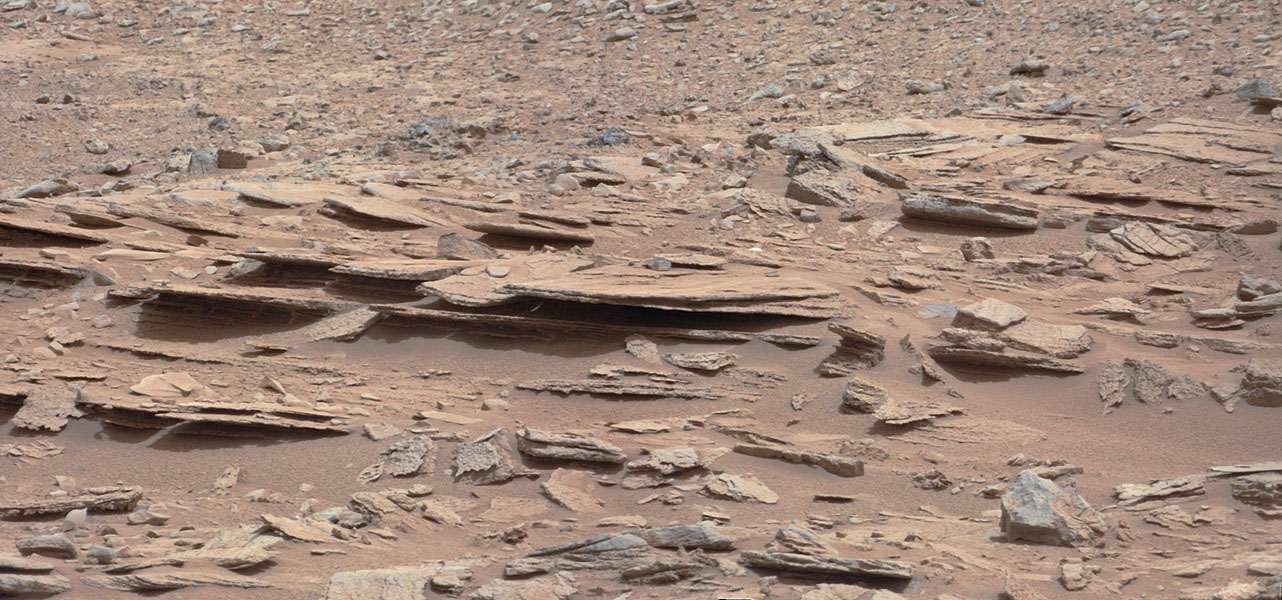 The NASA Mars rover Curiosity used its Mast Camera (Mastcam) during the mission's 120th Martian day, or sol (Dec. 7, 2012), to record this view of a rock outcrop informally named 'Shaler.'