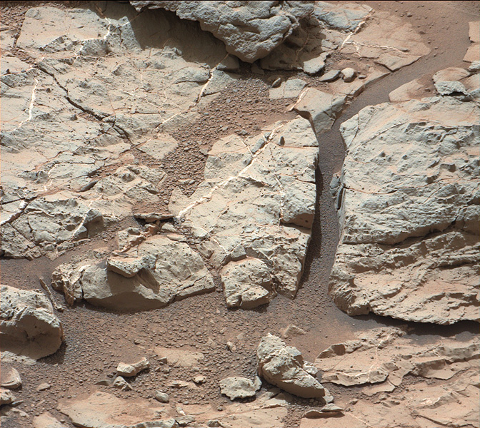 This image of an outcrop at the 'Sheepbed' locality, taken by NASA's Curiosity Mars rover shows well-defined veins filled with whitish minerals, interpreted as calcium sulfate.
