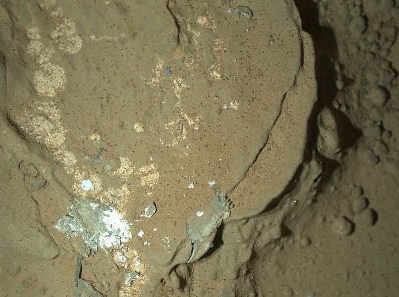 A Martian rock in the 'Yellowknife Bay' area of Mars' Gale Crater is illuminated by white-light light emitting diodes is part of the first set of nighttime images taken by the MAHLI camera at the end of the robotic arm of NASA's Mars rover Curiosity.