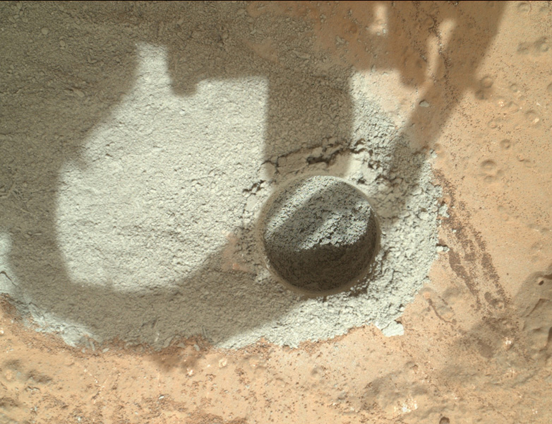 In an activity called the 'mini drill test,' NASA's Mars rover Curiosity used its drill to generate this ring of powdered rock for inspection in advance of the rover's first full drilling.