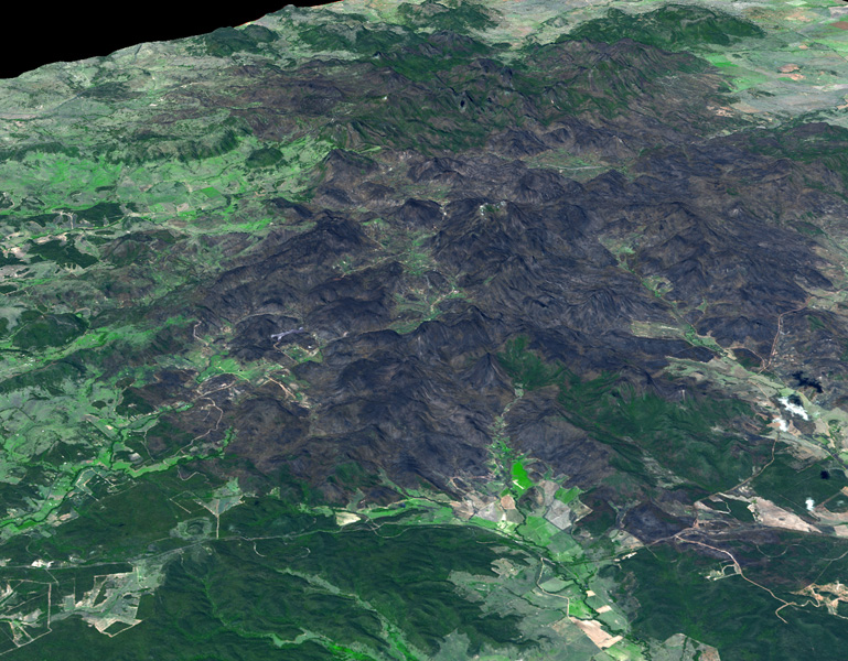 This 3-D view was created from data acquired Feb. 4, 2013 by NASA's Terra spacecraft showing a massive wildfire which damaged Australia's largest optical astronomy facility, the Siding Spring Observatory.