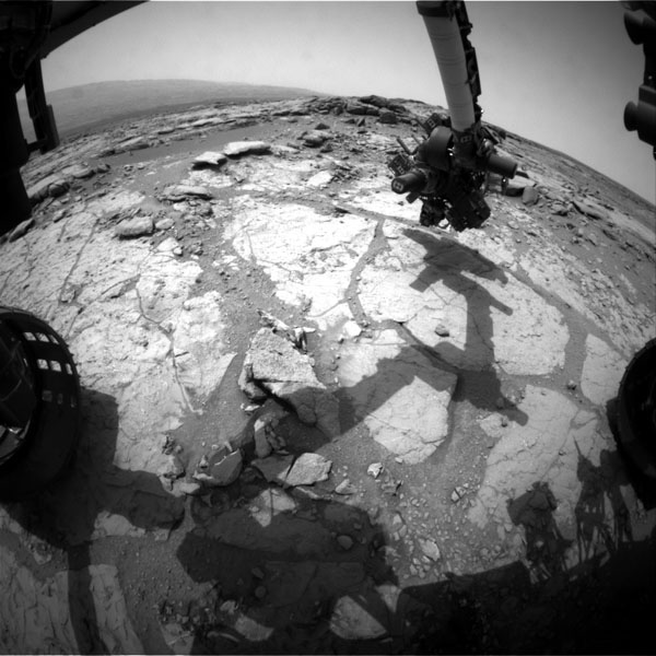 NASA's Mars rover Curiosity used its front left Hazard-Avoidance Camera for this image of the rover's arm over the drilling target