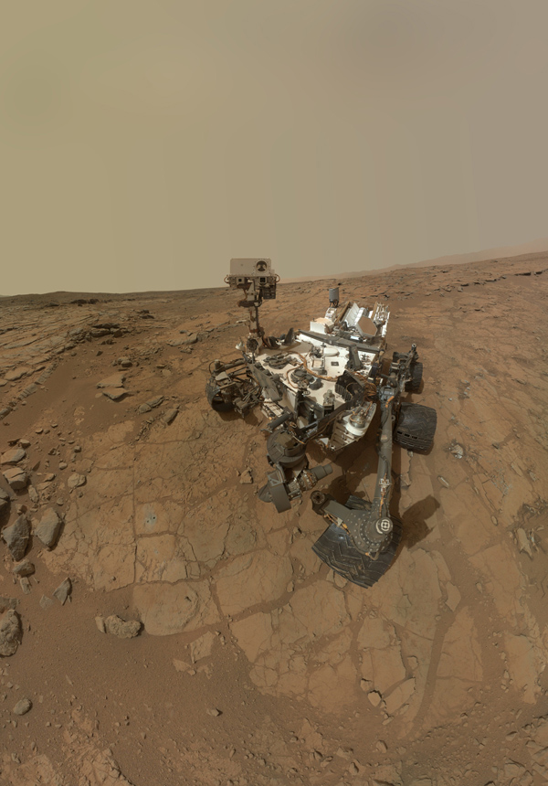 This self-portrait of NASA's Mars rover Curiosity combines dozens of exposures to show gray-powder and two holes where Curiosity used its drill on the rock target 'John Klein.'