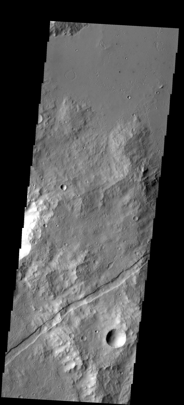 A graben is a downdropped block of material bounded on both sides by faults. The graben in this image from NASA's 2001 Mars Odyssey spacecraft follows the trend of the nearby Sirenum Fossae graben.