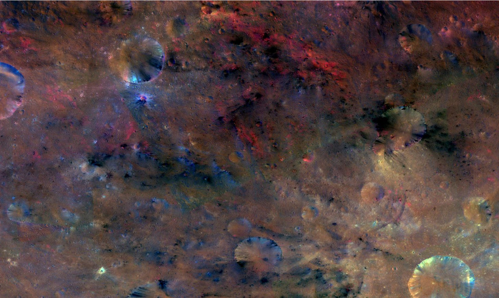 This colorized composite image from NASA's Dawn mission shows the crater Antonia, which lies in the enormous Rheasilvia basin in the southern hemisphere of the giant asteroid Vesta.