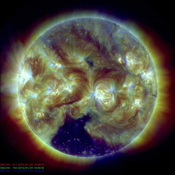 A large, dark coronal hole at the bottom of the Sun has been the most dominant feature this week (Jan. 29, 2014) as seen by NASA GSFC's Solar Dynamics Observatory.