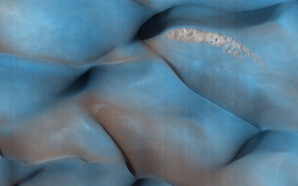 Why are these dunes different colors? Sand on Mars is typically dark in tone, as it commonly derived from volcanic rocks like lava flows as shown by NASA's Mars Reconnaissance Orbiter.