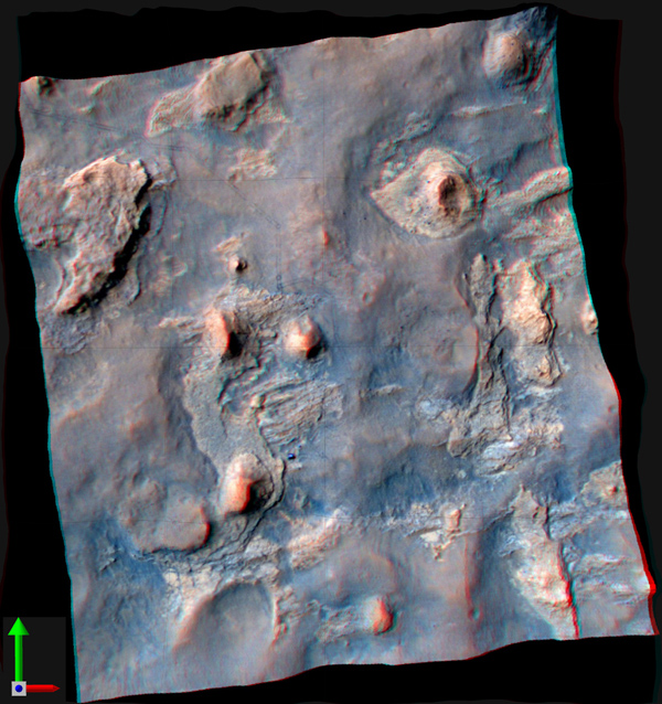 NASA's Curiosity Mars rover and its tracks are visible in this view combining information from three observations by the HiRISE camera on NASA's Mars Reconnaissance Orbiter. You need 3-D glasses to view this image.