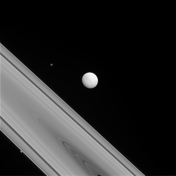 NASA's Cassini spacecraft captures a rare family photo of three of Saturn's moons that couldn't be more different from each other. Shown here are Tethys (center), Hyperion (upper left), and Prometheus (lower left).