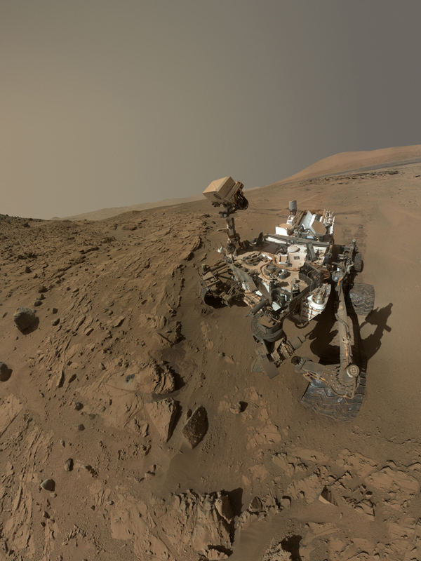 NASA's Curiosity Mars rover used the MAHLI camera at the end of its arm in April and May 2014 to take dozens of component images combined into this self-portrait where the rover drilled into a sandstone target called 'Windjana.'