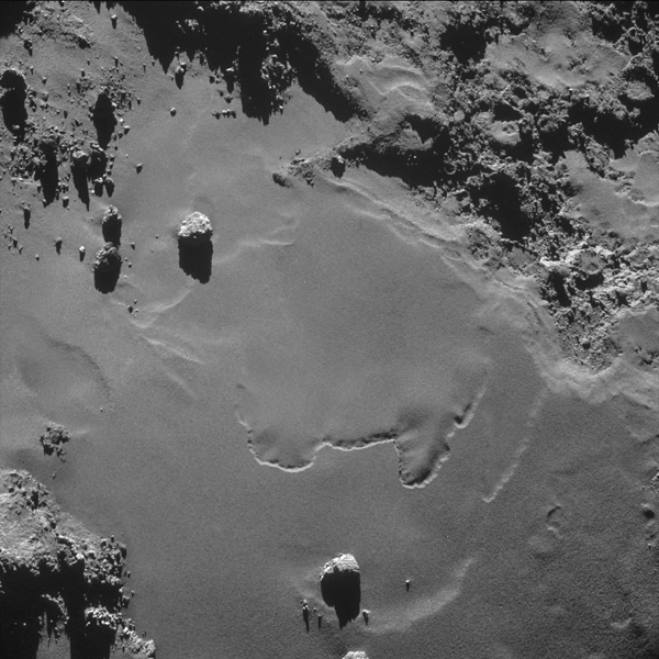 A patch of relatively smooth ground on the nucleus surface of comet 67P/Churyumov-Gerasimenko appears in this image taken by the navigation camera on the European Space Agency's Rosetta spacecraft in October 2014.