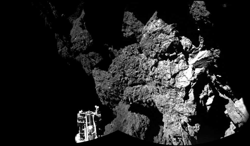 The Philae lander of the European Space Agency's Rosetta mission is safely on the surface of Comet 67P/Churyumov-Gerasimenko, as these first two images from the lander's CIVA camera confirm. One of the lander's three feet can be seen in the foreground.