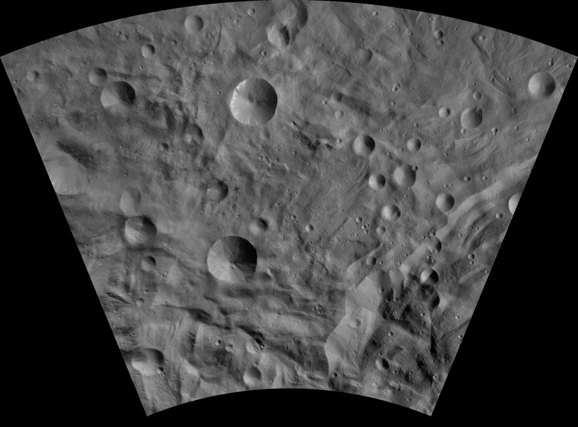 This image of Sextilia AV-L-26, from the atlas of the giant asteroid Vesta, was created from images taken as NASA's Dawn mission flew around the object, also known as a protoplanet.