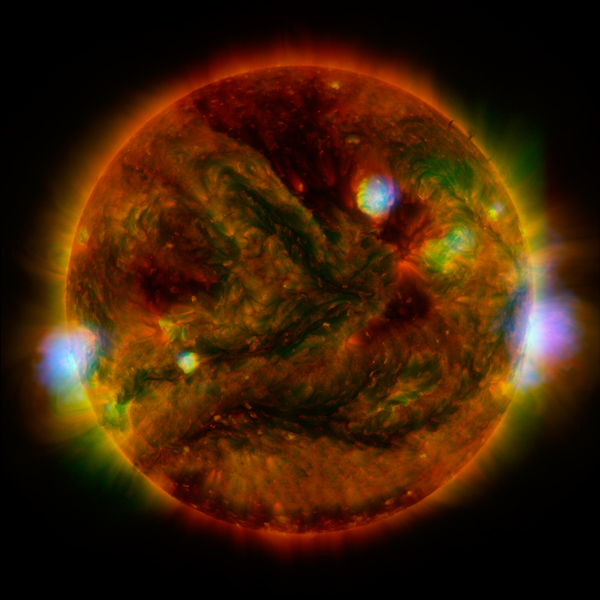Flaring, active regions of our sun are highlighted in this image combining observations from several telescopes. During the observations, microflares went off, which are smaller versions of the larger flares that also erupt from the sun's surface.