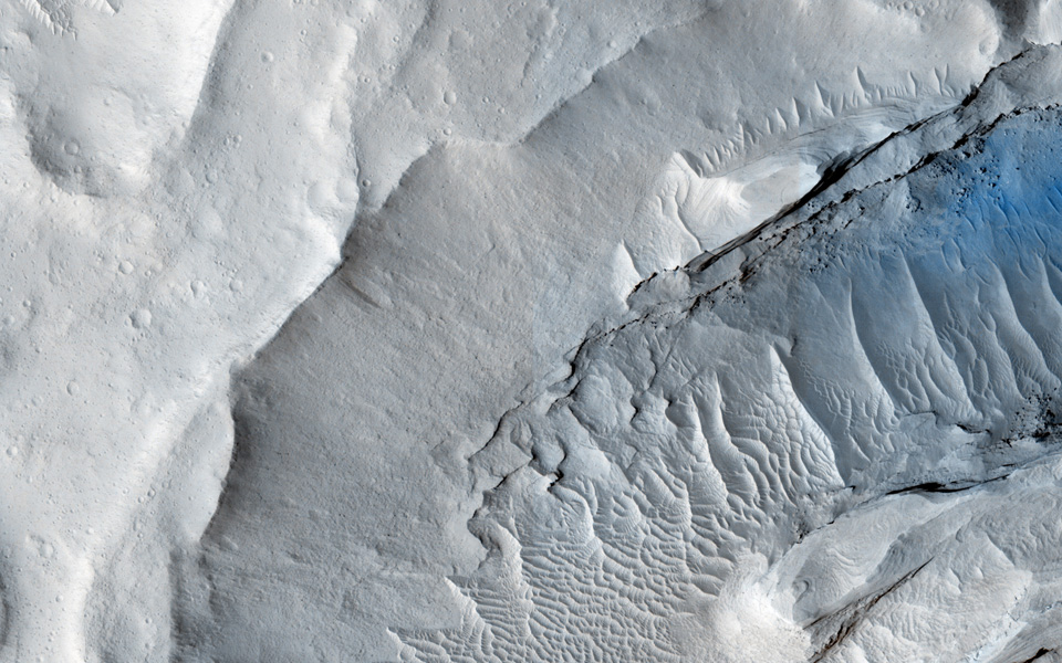 A delta is a pile of sediment dumped by a river where it enters a standing body of water. Evidence for deltas that formed billions of years ago on Mars has been mounting in recent years. This image is from NASA's Mars Reconnaissance Orbiter.
