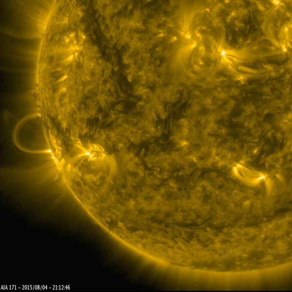 This still image from an animation from NASA GSFC's Solar Dynamics Observatory shows magnetically charged particles forming a nicely symmetrical arch at the edge of the Sun as they followed the magnetic field lines of an active region (Aug.4-5, 2015).