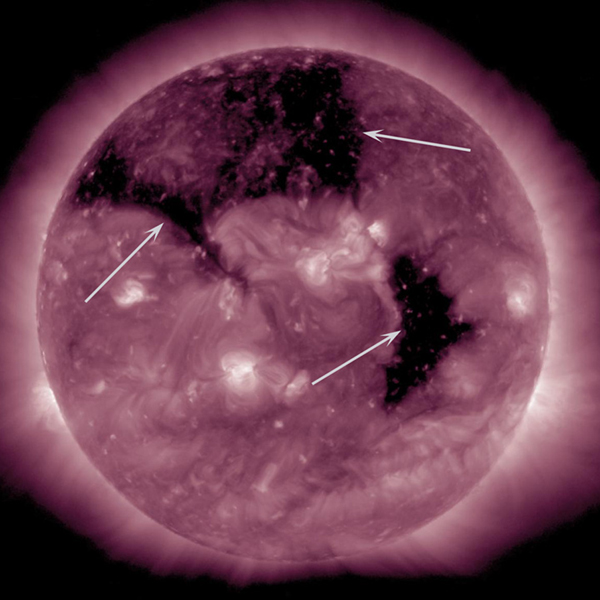 Three substantial coronal holes rotated across the face of the Sun the week of Sept. 8-10, 2015 as seen by NASA's Solar Dynamics Observatory. Coronal holes are areas where the Sun's magnetic field is open and a source of streaming solar wind.