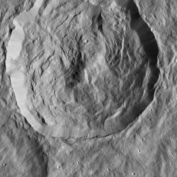 This Cerean crater, which is covered in ridges and steep slopes, called scarps, was captured by NASA's Dawn spacecraft on Dec. 23, 2015. These features likely resulted when the crater partly collapsed during its formation.