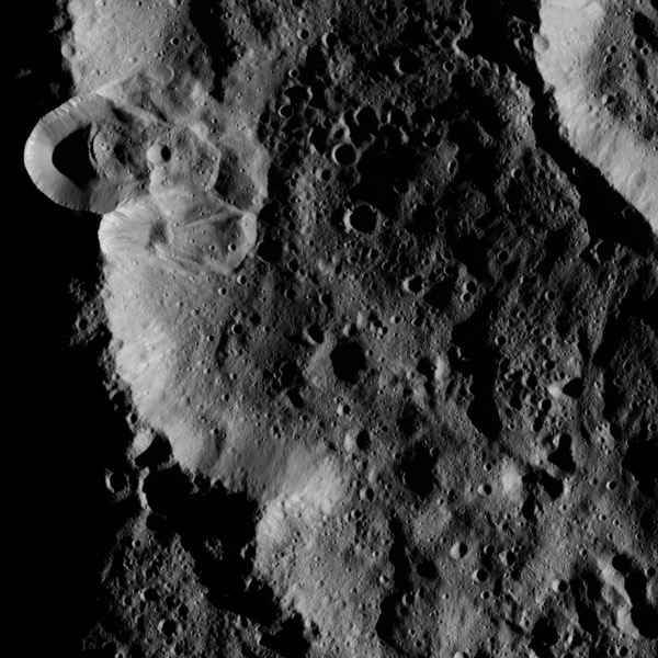 This image, taken by the framing camera aboard NASA's Dawn spacecraft, shows several unnamed craters superimposed upon one another. The low sun angle enhances the topography of this densely cratered region.