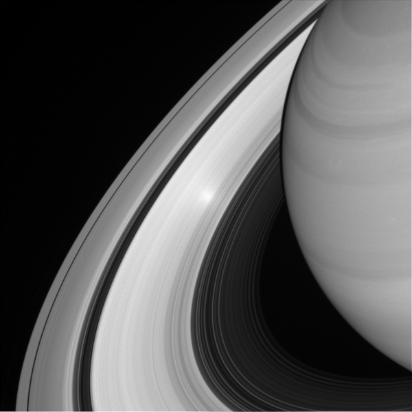 An ethereal, glowing spot appears on Saturn's B ring in this view from NASA's Cassini spacecraft. The glowing effect is an example of an 'opposition surge' making that area on the rings appear extra bright.