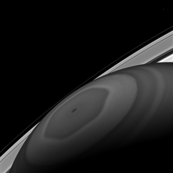 The north pole of Saturn sits at the center of its own domain. Around it swirl the clouds, driven by the fast winds of Saturn, as seen by NASA's Cassini spacecraft.